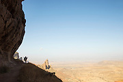 Man overlooking the Hawzen Mountain rages from the Mariam Korkor Church, Tigray, Ethiopia, Horn of Africa