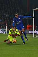 Football - 2016 / 2017 Premier League - AFC Bournemouth vs. Leicester City<br /> <br /> Bournemouth's Artur Boruc dives on a loose ball ahead of Islam Slimani of Leicester City at Dean Court (The Vitality Stadium) Bournemouth<br /> <br /> COLORSPORT/SHAUN BOGGUST