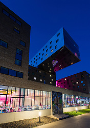 New modern Nhow hotel at night in Berlin Germany