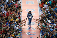 Danica Patrick greets fans while walking down a runway during driver introductions before a NASCAR cup auto race in Daytona Beach, Fla., Saturday, July 1, 2017. (Phelan M. Ebenhack via AP)