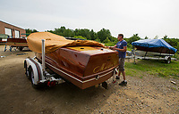 """Kevin Buttermore of Hi Gloss Boat Restoration uncovers """"Maiden '49"""" at his shop for renovation work in Gilford, NH.   ©2018 Karen Bobotas Photographer"""