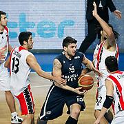 Anadolu Efes's Estaban Batista (C) during their Turkish Basketball League match Anadolu Efes between Bandirma Kirmizi at Sinan Erdem Arena in Istanbul, Turkey, Saturday, December 24, 2011. Photo by TURKPIX