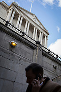 On the day that Chancellor of the Exchequer Rishi Sunak unveiled a £30bn package to boost the economy and get the country through the coronavirus outbreak, a Londoner descends the steps into Bank Underground Station in the capital's financial district, beneath the walls of the Bank of England as its governor Mark Carney cut the interest rate from 0.75% to 0.25%, on 11th March 2020, in the City of London, England.