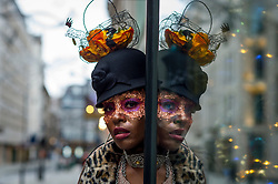 © Licensed to London News Pictures. 26/12/2020. LONDON, UK.  A model takes part in a Boxing Day flashmob through St James's for designer Pierre Garroudi.  Photo credit: Stephen Chung/LNP