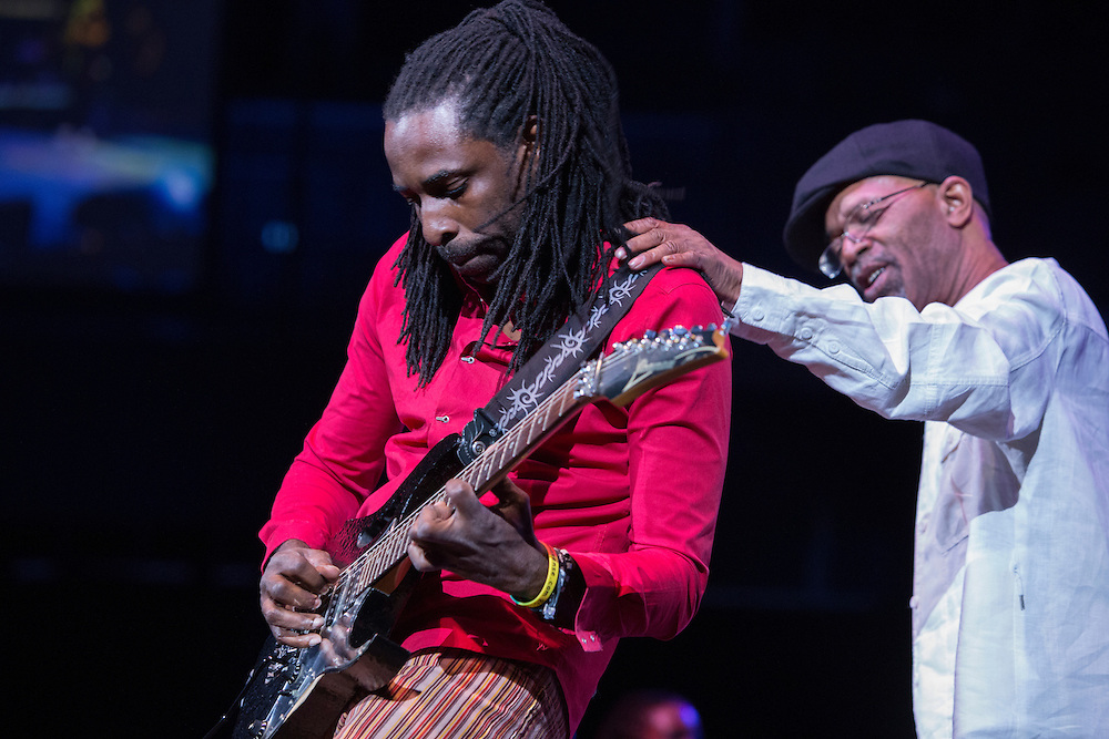 Beres Hammond with his hand on his guitarist's shoulder during a performance at The Biolife Sounds of Reggae at the Barclays Center.