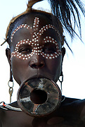 Young woman with lip plate and face painted, Mursi Tribe, Mago National Park, Lower Omo Valley, Ethiopia, portrait, person, one, tribes, tribal, indigenous, peoples, Southern, ethnic, rural, local, traditional, culture, primitive