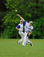 Gilford's Cody Boucher makes a play from deep center field during NHIAA division III baseball with White Mountain on Tuesday afternoon.  (Karen Bobotas/for the Laconia Daily Sun)