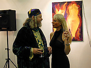 Ulla and The Marquess of Bath. Private view of 'A Vision of Romance' One Woman show of paintings by Ulla. The Atrium Gallery. Whitleys, Queensway, London. 22/2/00<br />© Copyright Photograph by Dafydd Jones 66 Stockwell Park Rd. London SW9 0DA Tel 0171 733 0108 www.dafjones.com