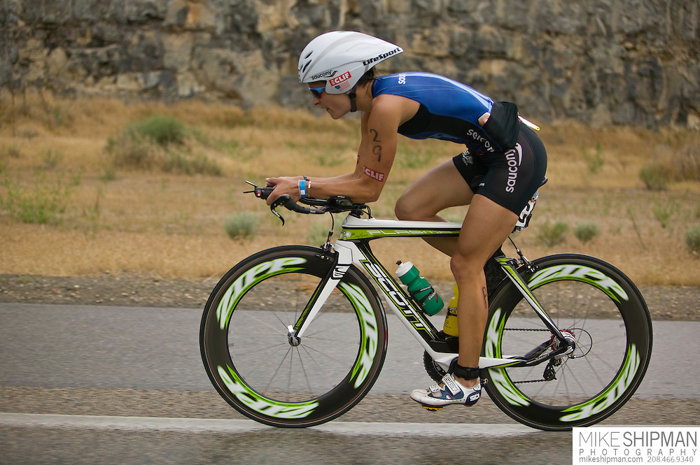 Idaho, Ada County, Boise, Boise 70.3 Ironman, Linsey Corbin from Missoula, MT, cycles in the desert south of Boise, finishing second behind Magali Tisseyre with a time of 4:20:58