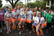 Walkers with Net Conversion pose at the start line during the IOA Corporate 5K in Orlando, Fla., Thursday, April 13, 2017. (Phelan M. Ebenhack via AP)