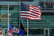 The American flag waves during the national anthem before a game between the Baltimore Orioles and Minnesota Twins at Target Field in Minneapolis, Minnesota on July 16, 2012.  The Twins defeated the Orioles 19 to 7 setting a Target Field record for runs scored by the Twins.  © 2012 Ben Krause