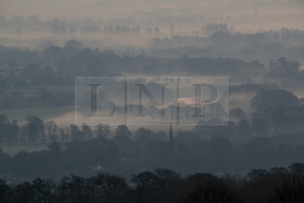 © Licensed to London News Pictures. 25/01/2017. Ilkley, UK. Thick fog covers the Yorkshire countryside as the sun rises on a cold January morning in Ilkley, West Yorkshire. Temperatures were milder this morning but most of the country still saw thick fog. Photo credit : Ian Hinchliffe/LNP