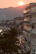 High angle view on Cannes city block of flats and congested street at sunset, Cannes, France