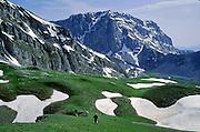Hike alpine meadows towards Mount Astraka (7990 feet), a peak of the Tymfi Massif, in the north Pindus Mountains (Pindos or Pindhos), Zagoria, Epirus/Epiros, Greece, Europe. Mount Tymfi (or Greek: , also transliterated Timfi, Tymphe, or Tymphi) is near the 40 degree parallel. Zagori (Greek: ) is a region and a municipality in the Pindus mountains in Epirus, in northwestern Greece. Zagori contains 45 villages collectively known as Zagoria (Zagorochoria or Zagorohoria).