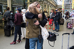 © Licensed to London News Pictures. 08/08/2021. London, UK. EUROSTAR travellers from Paris, France arrive at St Pancras train station on the first day COVID quarantine restrictions are lifted for fully vaccinated travellers. The UK government announced it has decided to waiver the 10 days of self-isolation requirement from amber countries, provided they have evidence of being given both Covid-19 jabs. Photo credit: London News Pictures