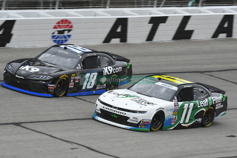 February 23, 2019 - Hampton, GA, U.S. - HAMPTON, GA - FEBRUARY 23: Justin Haley, Kaulig Racing, Chevrolet Camaro LeafFilter Gutter Protection (11) and Jeffrey Earnhardt, Joe Gibbs Racing, Toyota Supra Extreme Concepts/ik9 (18) race side by side during the Xfinity Series Rinnai 250 on February 23, 2019, at Atlanta Motor Speedway in Hampton, GA.(Photo by Jeffrey Vest/Icon Sportswire) (Credit Image: © Jeffrey Vest/Icon SMI via ZUMA Press)