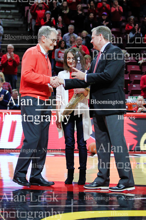 NORMAL, IL - February 02:  Dick Ludtke and his wife stand with Athletic Director Larry Lyons at half court being honored for Dick's 1000th Redbird basketball broadcast during a college basketball game between the ISU Redbirds and the University of Loyola Chicago Ramblers on February 02 2019 at Redbird Arena in Normal, IL. (Photo by Alan Look)