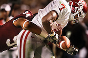 Nov 6, 2010; College Station, TX, USA; Texas A&M Aggies defensive tackle Damontre Moore (94) tackles Oklahoma Sooners running back DeMarco Murray (7) during the third quarter at Kyle Field. Mandatory Credit: Thomas Campbell-US PRESSWIRE
