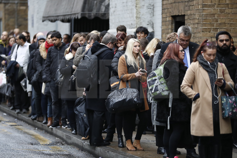 © Licensed to London News Pictures. 09/01/2017. London, UK. Commuters queue for buses near Waterloo Station as a 24 hour London Underground tube strike takes hold.  All Zone one tube stations are closed until 6PM tonight after members of the RMT and the Transport Salaried Staffs' Association unions walked out after talks with TFL collapsed.  Photo credit: Peter Macdiarmid/LNP