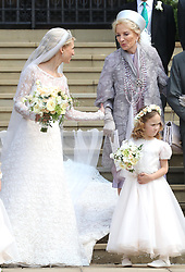 Newlywed Lady Gabriella Windsor with her mother Princess Michael of Kent and a young bridesmaid on the steps of the chapel with their bridesmaids, page boys and guests after their wedding at St George's Chapel in Windsor Castle.
