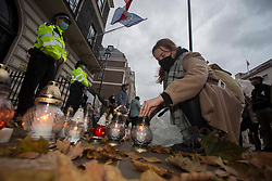 © Licensed to London News Pictures. 24/10/2020. London, UK. Protestors burn candles outside the embassy of the Republic of Poland, central London. Due to decision of Poland's highest court which ruled  that abortions to fetal defects are unconstitutional, moving the country towards a near-total ban on terminations and sparking angry protests in the capital Warsaw. Photo credit: Marcin Nowak/LNP