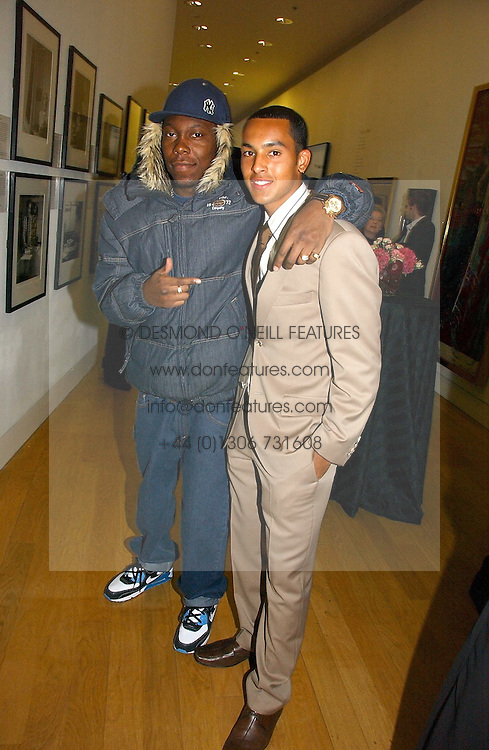Left to right, rapper & poet DIZZEE RASCAL and footballer THEO WALCOTT at the opening of an exhibition entitled Exceptional Youth supported by Teen Vogue at the National Portrait Gallery, London on 3rd November 2006.<br /><br />NON EXCLUSIVE - WORLD RIGHTS