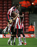 Photo: Lee Earle/Sportsbeat Images.<br /> Southampton v Hull City. Coca Cola Championship. 08/12/2007. Southampton's Stern John is mobbed after scoring completing his hat-trick.