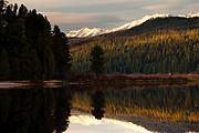 Swan Mountains reflecting on Seeley Lake, Montana.