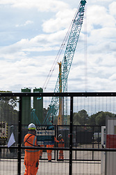Harefield, UK. 13 July, 2020. A drilling rig being prepared for use in connection with the HS2 high-speed rail link adjacent to Harvil Road. Environmental campaigners have highlighted the risk of contamination to the chalk aquifer which supplies around 22% of London's drinking water if drilling takes place.