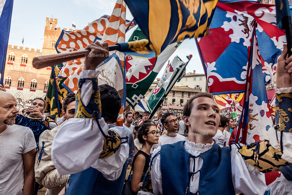Italy, Siena, the Palio: all the supporters of all the contradas goes to celebrate the winners