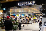 Security restrict the number of customers allowed in Foodland at Pasadena. New COVID Lockdown Restrictions announced today by the SA Premier Steven Marshall caused panic shopping at supermarkets as people stocked up with essential groceries.   (Photo by Peter Mundy/Speed Media)