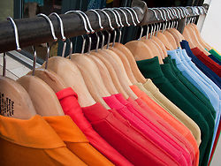 Racks of colourful shirts hanging outside fashion boutique in bohemian Friedrichshain district of Berlin Germany