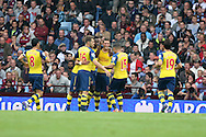 Mezut Ozil of Arsenal (centre) celebrates scoring his side's first goal with team-mates. Barclays Premier league match, Aston Villa v Arsenal at Villa Park in Birmingham on Saturday 20th Sept 2014<br /> pic by Mark Hawkins, Andrew Orchard sports photography.