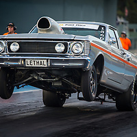 Leigh Fallon (1560) with a huge wheelstand in his Ford Falcon XW ute while competing in Super Sedan at Perth Motorplex.