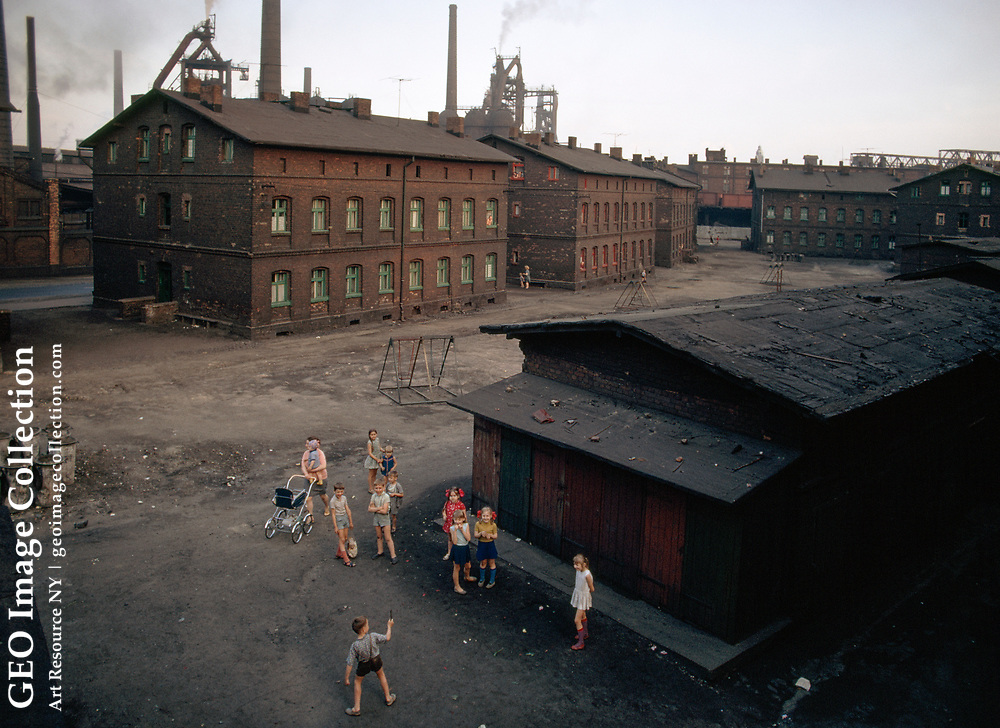 Children play in sahdow of the Peace Steel Mill.