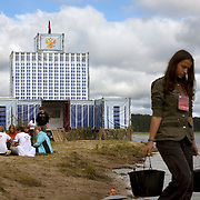 "Pro-Putin Nashi youths attend a lecture in front of a mock Parliament building (""the White House"") during a summer camp on Lake Seliger in Russia. The yearly camp, organised by the nationalistic group, trains youth in political activism."