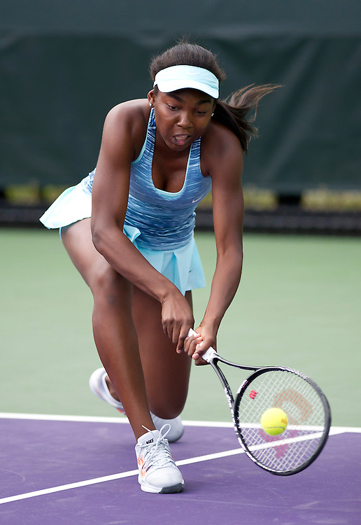 Francoise Abanda (CAN) in action during her defeat by Kimiko Date-Krumm (JPN) in their Womens Qualifying Singles Final Round match today - Kimiko Date-Krumm (JPN) def Francoise Abanda (CAN) 7-6(4) 4-6 6-4<br /> <br /> Photographer Andrew Patron<br /> <br /> Tennis - Sony Open Tennis - ATP World Tour Masters 1000 - Day 2 - Tuesday 18th March 2014 - Tennis Center at Crandon Park Key Biscayne, Miami, Florida USA<br /> <br /> © CameraSport - 43 Linden Ave. Countesthorpe. Leicester. England. LE8 5PG - Tel: +44 (0) 116 277 4147 - admin@camerasport.com - www.camerasport.com
