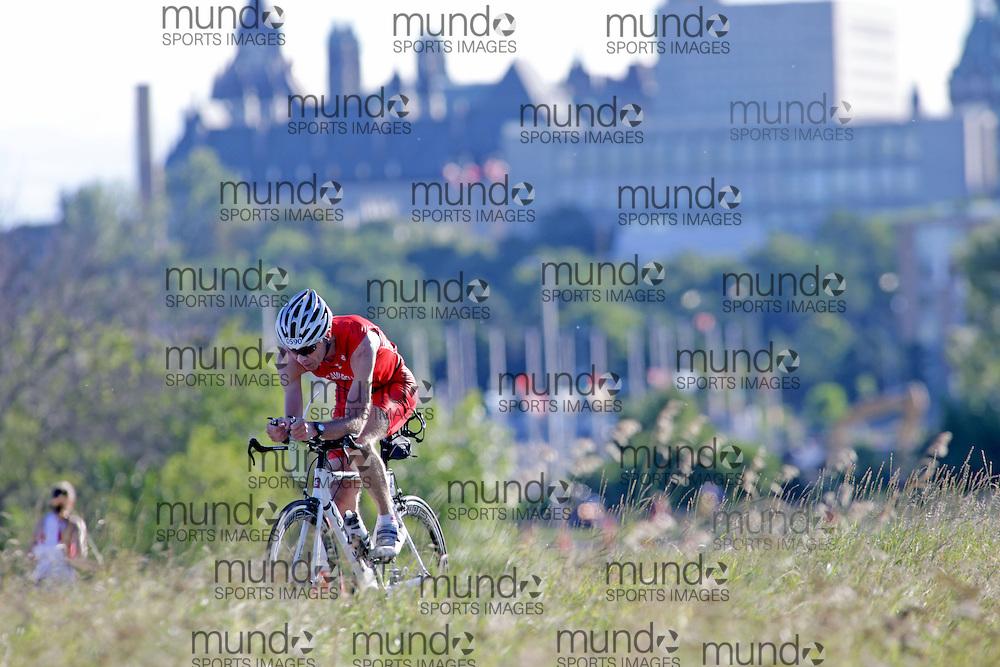 (Ottawa, Canada---10 August 2013)  Ian Campbell (590)  of Canada (CAN) competing in the 55-59 Male AG International Triathlon Union 2013 World Duathlon Championships (10 km run- 40 km bike- 5km run).