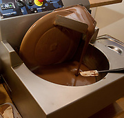 Mixing and blending Dark chocolate by an artisanal chocolatier