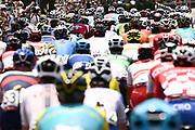 Picture by Alex Broadway/SWpix.com - Tokyo 2020 Olympics - 24/07/2021 - Cycling Men's Road Race - Musashinonomori Park to Fuji International Speedway, Japan - The peloton moves through the outskirts of Tokyo