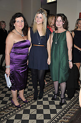 Left to right, DEBORAH HORSMAN, PHOEBE HARRISON and CAROL PASCOE-HARRISON at a fashion show by Catherine Walker & Co in support of The Haven held at One Mayfair, North Audley Street, London on 18th May 2011.