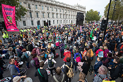 © Licensed to London News Pictures. 07/10/2019. London, UK. Climate change activists stage a sit down demonstration on Whitehall, London, closing the road to traffic, as part of a wider two week long demonstration to cause disruption in the capital. The activists are calling for the government to acknowledge and act on climate change. Photo credit : Tom Nicholson/LNP