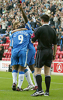 Fotball<br /> England<br /> Foto: SBI/Digitalsport<br /> NORWAY ONLY<br /> <br /> Coca-Cola Championship.<br /> <br /> Wigan Athletic v Cardiff City<br /> <br /> 30/08/2004.<br /> <br /> Wigan's Jason Roberts celebrates his goal and teams second with Nathan Ellington and Jimmy Bullard