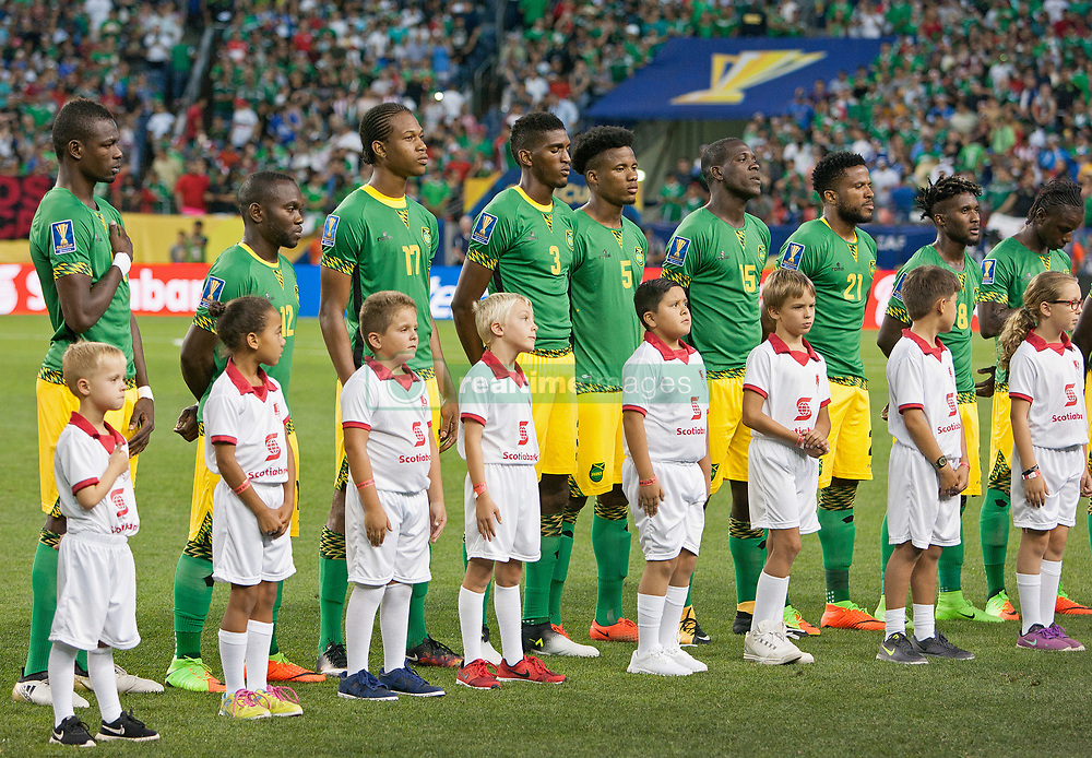 July 13, 2017 - Denver, Colorado, U.S - The Jamacian Soccer team stand at attention during the National Anthem at Sports Authority Field at Mile High during the CONCACAF Gold Cup tournament Thursday night. Mexico ties Jamacia 0-0. (Credit Image: © Hector Acevedo via ZUMA Wire)