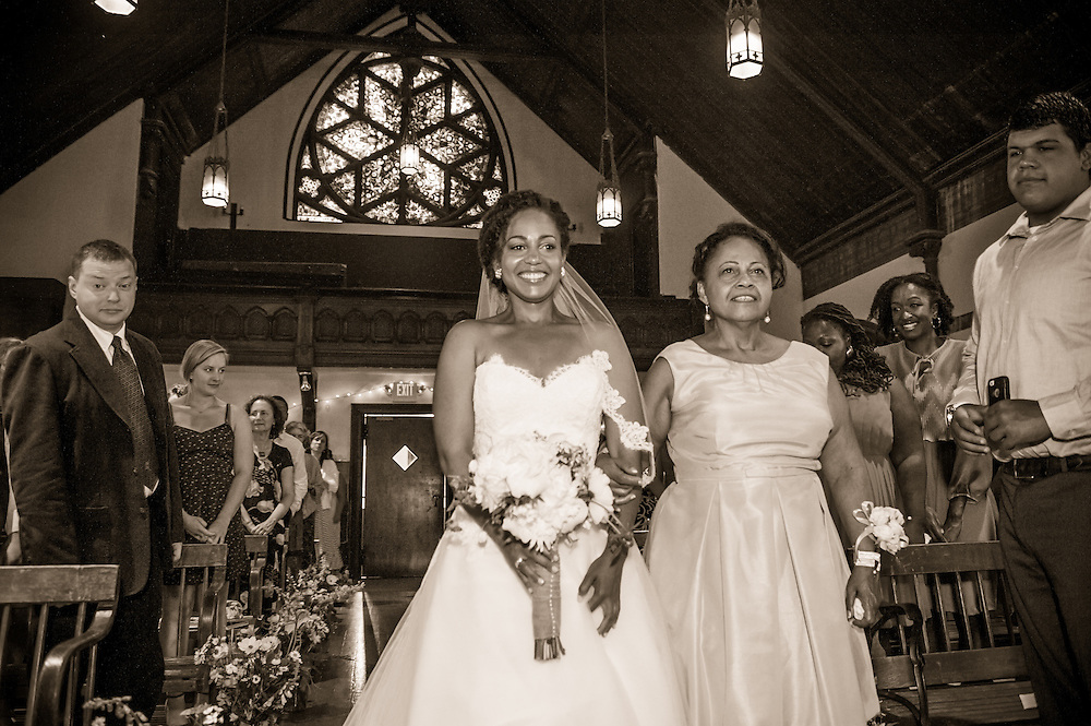 A bride enters the church with her mother in Brattleboro, VT.