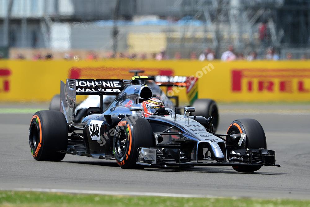 Kevin Magnussen (McLaren-Mercedes) leads Nico Hulkenberg (Force India-Mercedes) in the 2014 British Grand Prix in Silverstone. Photo: Grand Prix Photo