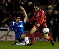 Photo: Jed Wee.<br />Oldham Athletic v Chasetown. The FA Cup. 16/11/2005.<br /><br />Chasetown's Duncan Horler (R) is tackled by Oldham's Danny Hall.