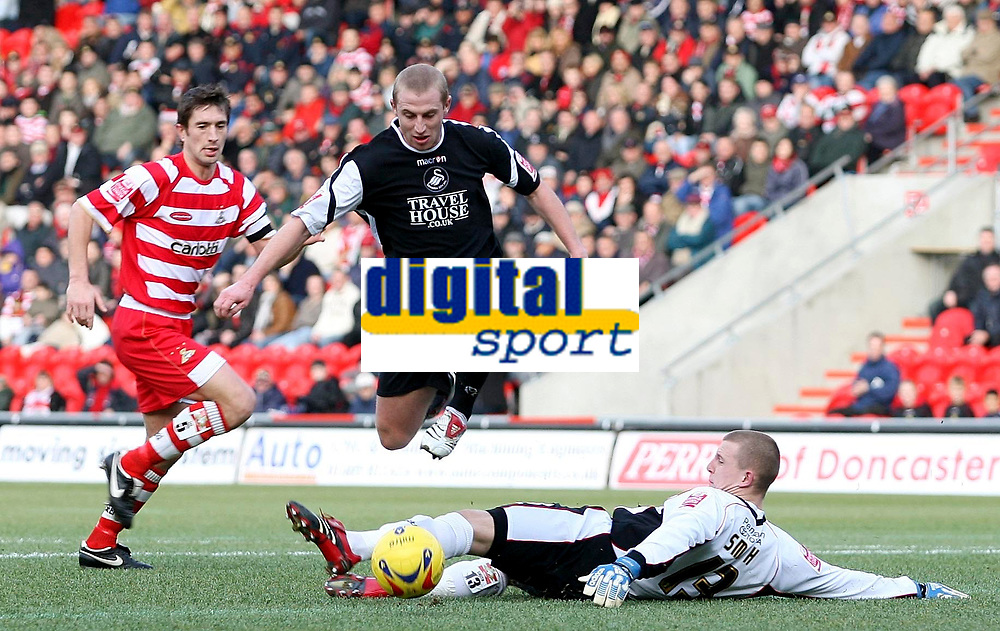 Photo: Paul Thomas.<br /> Doncaster Rovers v Swansea City. Coca Cola League 1. 17/02/2007.<br /> <br /> Ian Craney (Black) of Swansea beats keeper Ben Smith by going over him, but fails to score as he puts the ball wide.
