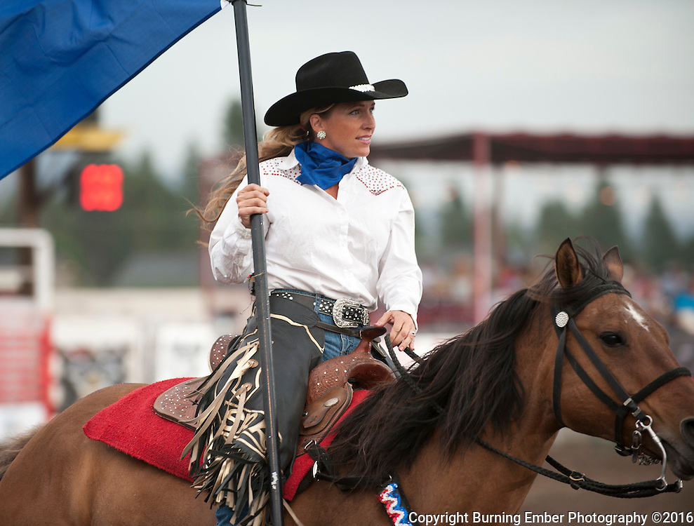 The Skagit Rein Riders present the event flags before the 2nd Perf in Coeur D'Alene Idaho on 08/27/16.  Josh Homer photo.  Photo credit must be given on all uses.  www.burningemberphotography.com