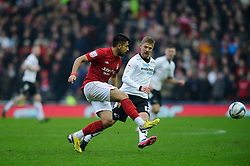 Nottingham Forest Defender Gonzalo Jara (CHI) clears past Derby Midfielder Michael Jacobs (ENG) during the second half of the match - Photo mandatory by-line: Rogan Thomson/JMP - Tel: Mobile: 07966 386802 19/01/2013 - SPORT - FOOTBALL - Pride Park - Derby. Derby County v Nottingham Forest - npower Championship. The meeting of these two local sides is known as the East Midlands Derby with the winner claiming the Brian Clough Trophy.
